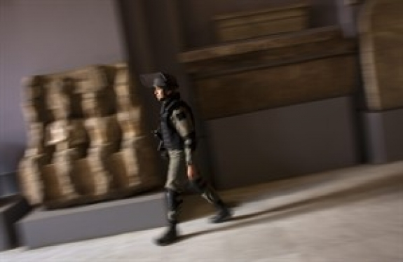 A member of the Egyptian special forces patrol on the main floor of the Egyptian Museum in Cairo, Egypt, Thursday, Feb. 10, 2011. Would-be looters broke into Cairo's famed Egyptian Museum on Saturday, Jan. 29, ripping the heads off two mummies and damaging about 75 small artifacts before being caught and detained by army soldiers.