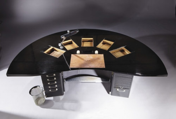 "A black lacquer ""Tardieu"" desk created by the Art Deco designer Emile-Jacques Ruhlmann sold for 2.3 million euros at Christie's International's three-day Paris auction of the Gourdon Collection of 20th-century design. The desk was estimated to sell for between 2 million euros and 3 million euros."