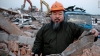 Chinese artist Ai Weiwei holds debris from his newly built Shanghai studio after the government demolished it without warning.