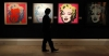 A Sotheby's employee poses in front of four screenprints all entitled ''Marilyn Monroe'' by Andy Warhol at Sotheby's in London September 13, 2010.