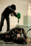 A protester belonging to the Liberate Tate group lies covered in an oil-like substance at Tate Britain in London. The protest marks the anniversary of the Deepwater Horizon explosion, with those taking part urging the Tate to take no more money from BP Plc