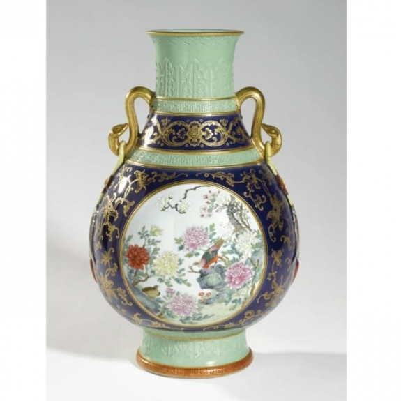 "An unusual ""famille rose"" and gold-decorated vase with molded design was sold for $18 million at Sotheby's in New York. It had been estimated to make just $800 to $1,200."