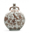 """A rare underglaze-red """"magpie and prunus"""" moonflask Qianlong seal mark and period. Estimate: £300,000-500,000."""
