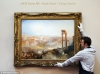 Under the hammer: A Sotheby's employee hangs the painting before the sale