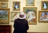 A visitor admires works at the eclectic Barnes Foundation