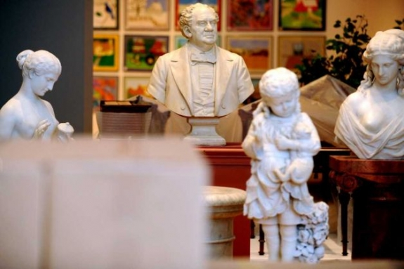 Marble busts, including one of P.T. Barnum, sit in the center of the first floor of The Barnum Museum awaiting relocation during restoration of the historic building following damage to its structure during the June 24, 2010 tornado.
