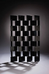 A 1920s black lacquer ``Brick'' screen, by Irish-born designer Eileen Gray, is estimated to fetch between 1.2 million euros and 1.5 million euros at Christie's International's auction of the Gourdon Collection of 20th-century design, to be held in Paris on March 29 through March 31.