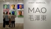 Visitors look at a ten-piece set paper screenprint of Mao Zedong by Andy Warhol, which is part of Warhol's series of the late Chinese leader, displayed at the Hong Kong Convention and Exhibition Centre during Christie's 2008 Spring Sales May 26, 2008.